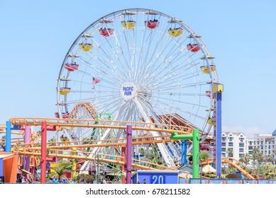 SANTA MONICA, USA - JUNE 12: The Ferris Wheel at the amusement park on the Santa Monica Pier in Santa Monica, California on June 12, 2017