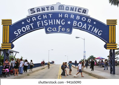 SANTA MONICA, USA - OCTOBER 15: Famous entrance sign to Santa Monica Pier on October 15, 2011 in Santa Monica, USA. There is an amusement park on the pier that is a famous tourist attraction
