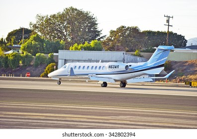 SANTA MONICA/CALIFORNIA - NOV. 22, 2015: Learjet-45 fixed wing multi engine (turbo fan) aircraft touches down on runway as it arrives at Santa Monica Airport in Santa Monica, California USA