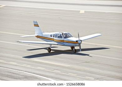 SANTA MONICA/CALIFORNIA - SEPT. 21, 2019: Piper PA-28-151 fixed wing single engine aircraft taxiing along the tarmac at Santa Monica Airport. Santa Monica, California USA