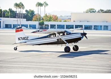SANTA MONICA/CALIFORNIA - SEPT. 21, 2019: Cessna A185F fixed wing single engine aircraft taxiing along the tarmac at Santa Monica Airport. Santa Monica, California USA