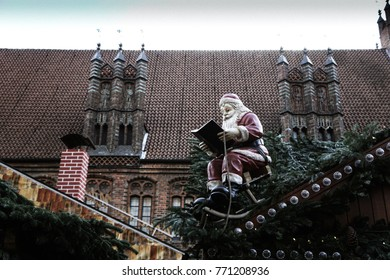 Santa on the roof reading book