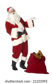 Santa on white background with open gift bag and teddy bear showing