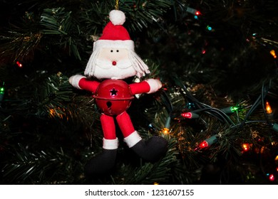 Santa Ornament with Jingle Bell Hanging on the Christmas Tree