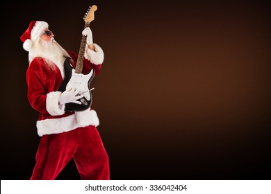 Santa playing electric guitar against dark brown background