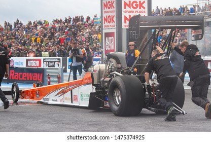 Santa Pod Raceway, UK, May 26 2019. Top fuel dragster pushed into staging area. Piloted by Mikael Kågered from Sweden. FIA/FIM The Main Event, European Drag Racing Competition.