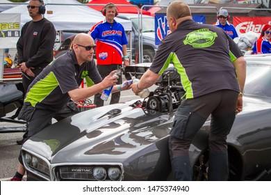 Santa Pod Raceway, UK, May 26 2019. Pro Modified Firebird stertup in the paddock. Driven by Kim Kristiansen, Denmark. FIA/FIM The Main Event, European Drag Racing Competition.