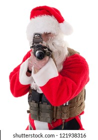 Santa pointing a gun directly at camera, wearing vest - white isolation