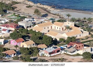 Santa Pola, Alicante Province, Spain - 03/25/2019.  The Calas del Cuartel with Alicante University's Marine Research Centre (CIMAR) and surrounding buildings below the lighthouse of Santa Pola.