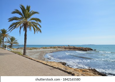 Santa Pola Cove Walway along the  Beach and Tabarca Island in the far distance in the costa blanca region of Alicante Spain - Shutterstock ID 1842165580