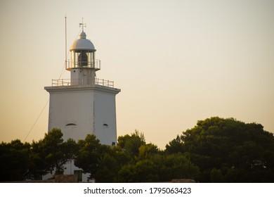 Santa Pola lighthouse at sunset - Shutterstock ID 1795063423