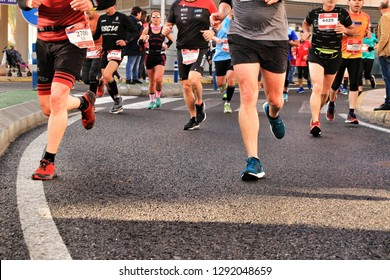 Santa Pola, Spain- January 20, 2019: Runners in the Half Marathon of the fishing village of Santa Pola, province of Alicante, on a sunny day in January