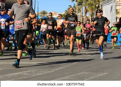 Santa Pola, Spain- January 21, 2018: Runners in the Half Marathon of the fishing village of Santa Pola, province of Alicante, on a sunny day in January