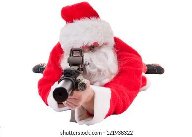 Santa in prone position pointing a gun - white isolation