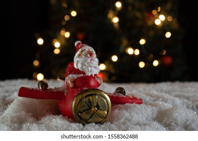 Santa in red plane in christmas background
