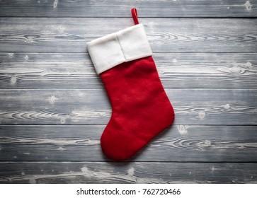Santa red sock isolated on grey board