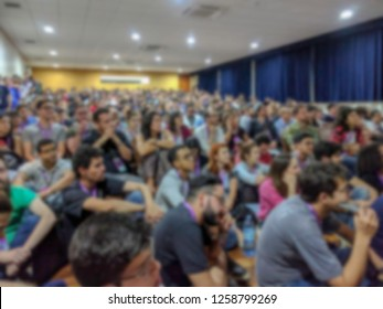 Santa Rita do Sapucaí, Minas Gerais / Brasil - September 7, 2018: A lot of people watching a presentation in an auditorium - Blurred Image