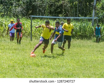 Santa Rita, Peru - Sep 19, 2018: Local people playing football in a small village in the middle of the Amazon Rain Forest, Border of Peru and Brazil