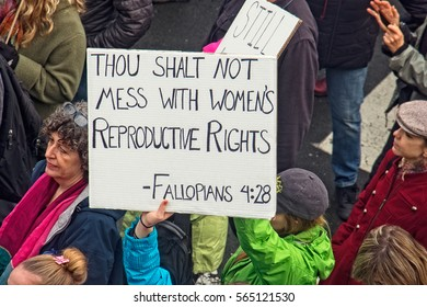 SANTA ROSA, CA /UNITED STATES-JANUARY 21, 2017:  A demonstrator carries a sign during the Woman's March.