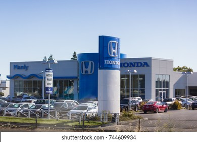 Santa Rosa, CA, USA - July 6,2017 : Sign of Honda Motor Logo with the office dealership in the background, Manly Honda Car Dealership, Santa Rosa, CA, USA