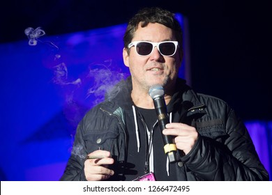 Santa Rosa, CA/USA - 12/16/2018: Comedian Doug Benson smokes a joint on stage at The Emerald Cup. He starred in Last Comic Standing, Super High Me, The High Court with Doug Benson.