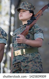 Santa Rosa, CA/USA: 6/16/2019: Female United States Marine Corp soldier stands at attention for the National Anthem at Country Summer Music Festival.