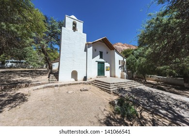 Santa Rosa Church in Purmamarca, near Cerro de los Siete Colores (The Hill of Seven Colors), in the colourful valley of Quebrada de Humahuaca in Jujuy Province, northern Argentina.