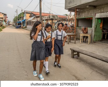 Santa Rosa, Peru - Sep 18, 2017: Children from the school wearing the uniforms walking  on the street of the small Peruvian  village.