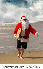 Santa running from large wave at beach