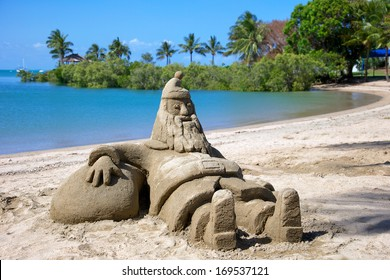 Santa sandcastle figure on Whitsunday beach