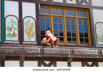 Santa sits high in a window ledge in downtown Ushuaia, Argentina.