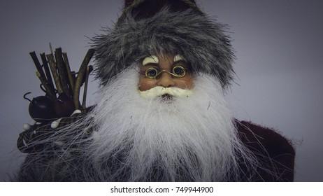 Santa toy face macro on white background