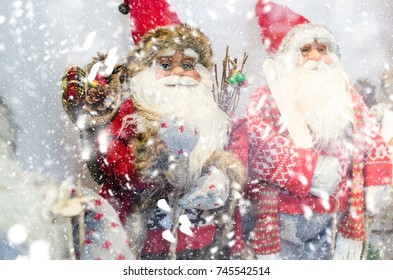 santa toy, a portrait of a santa with a beard, glasses and packets,snowflakes fall through the grandfather of the frost