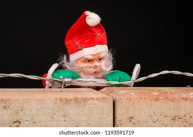 Santa trying to climb the wall, an immigration concept