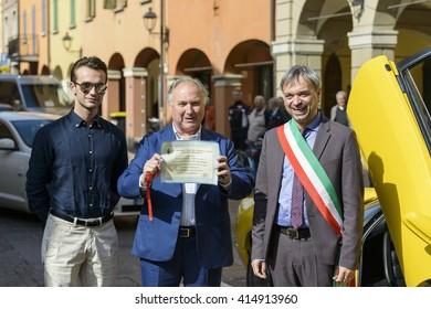 SANT'AGATA BOLOGNESE, ITALY - APRIL 30 2016 - Editorial: Tonino Lamborghini and son together with the Mayor of Sant'Agata Bolognese during the parade for the 100th anniversary Ferruccio Lamborghini