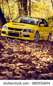 Santander, Cantabria / Spain, 11-18-2018: Mitsubishi Lancer Evolution 9, shot in a mountain road full of autumn leaves