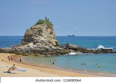 SANTANDER, SPAIN -4 JUL 2018- View of the Playa del Camello (Camel Beach), with a rock shaped like a camel, near the Magdalena Peninsula in Santander, Cantabria, Spain.