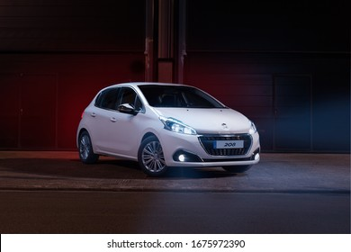Santander, Spain - February 22, 2020: Peugeot is a French automobile brand with more than 200 years of history, specialized in the manufacture of passenger cars. White Peugeot 208 blue hdi parked.