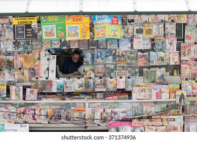 SANTANDER, SPAIN - JANUARY 27, 2016: saleswoman from a kiosk full of magazines and newspapers, in Santander, Cantabria, Spain