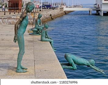 Santander, Spain - May 26, 2018: View of a statue of raqueros on waterfront in Santander, Spain