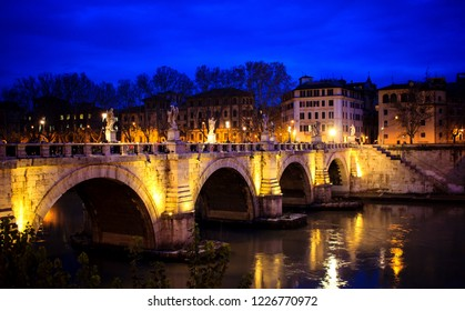 """Sant'Angelo bridge in Rome during a """"blue hour"""" between daytime and nightfall."""