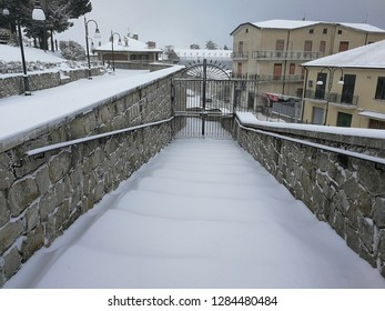 Sant'Angelo dei Lombardi, Campania, Italy - January 4, 2019: Ramp San Nicola in the historic center during a snowfall