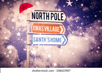 Santas address against blank sign posts against cloudy sky Digital image of blank sign posts against cloudy sky