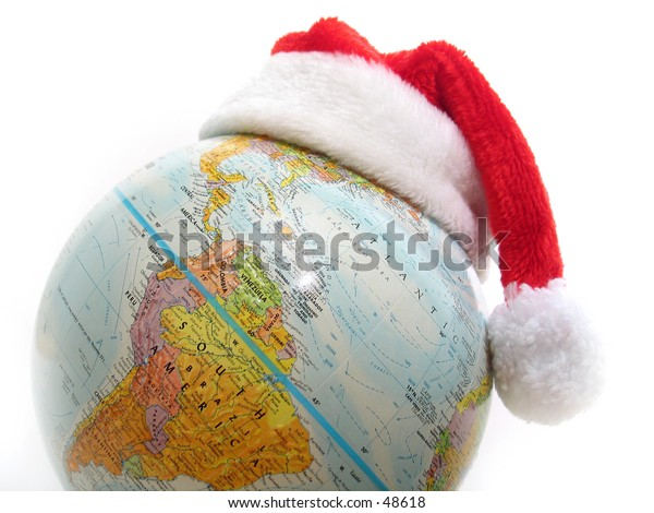 Santa's hat on top of a globe.