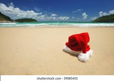 Santa's hat on a tropical beach