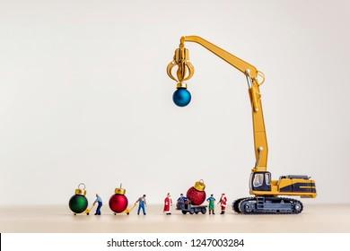 Santa's helpers carries Christmas balls.
