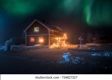 Santa's home in the north under the polar light and stars during winter time