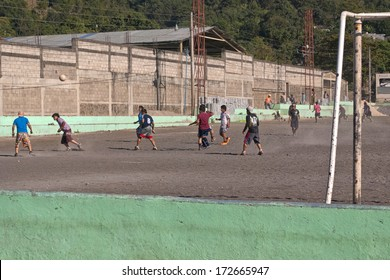 SANTIAGO ATITLAN, GUATEMALA - JAN 5 2010: A pickup game of soccer takes place in Santiago Atitlan on January 5, 2010.  Football (soccer) is Guatemala's most popular sport.