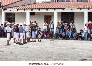 Santiago Atitlan, Guatemala â?? June 4, 2015: Indigenous Mayan locals invoke the spirits of the gods in a traditional festival in Santiago Atitlan, one of the largest towns on the Lake Atitlan.