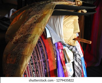 SANTIAGO ATITLAN, GUATEMALA / GUATEMALA  - NOVEMBER 2018: Maximon, a symbolic figure in Mayan spirituality, drinks and smokes together with shamans, keepers and visitors while offering them protection